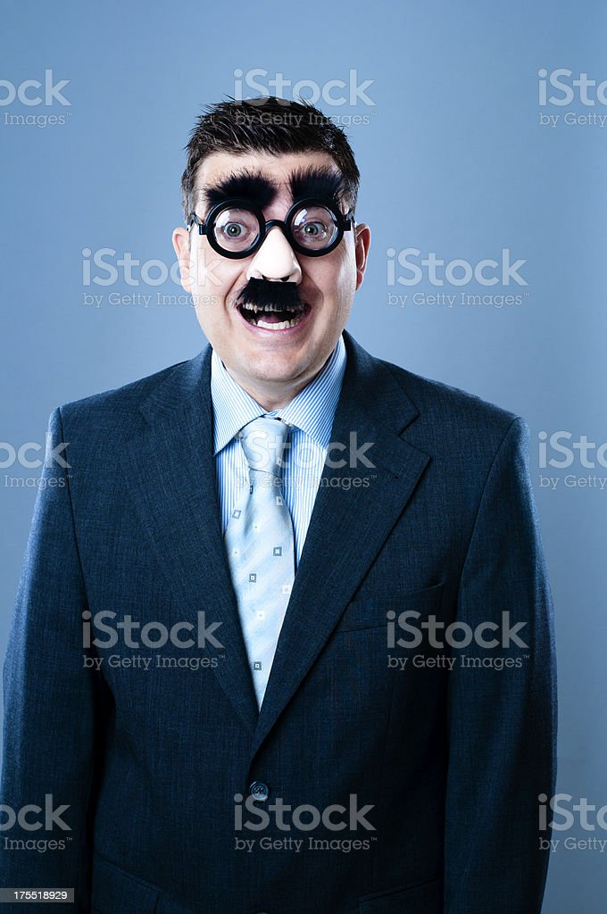 Very happy businessman in disguise stock photo