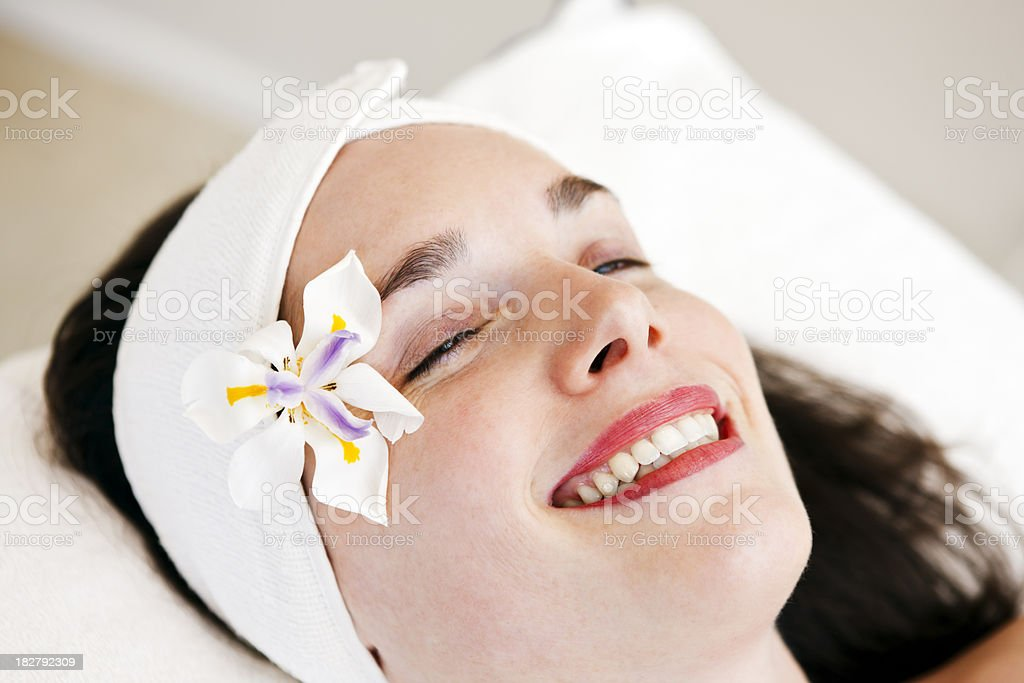 Very happy client relaxes at the spa stock photo