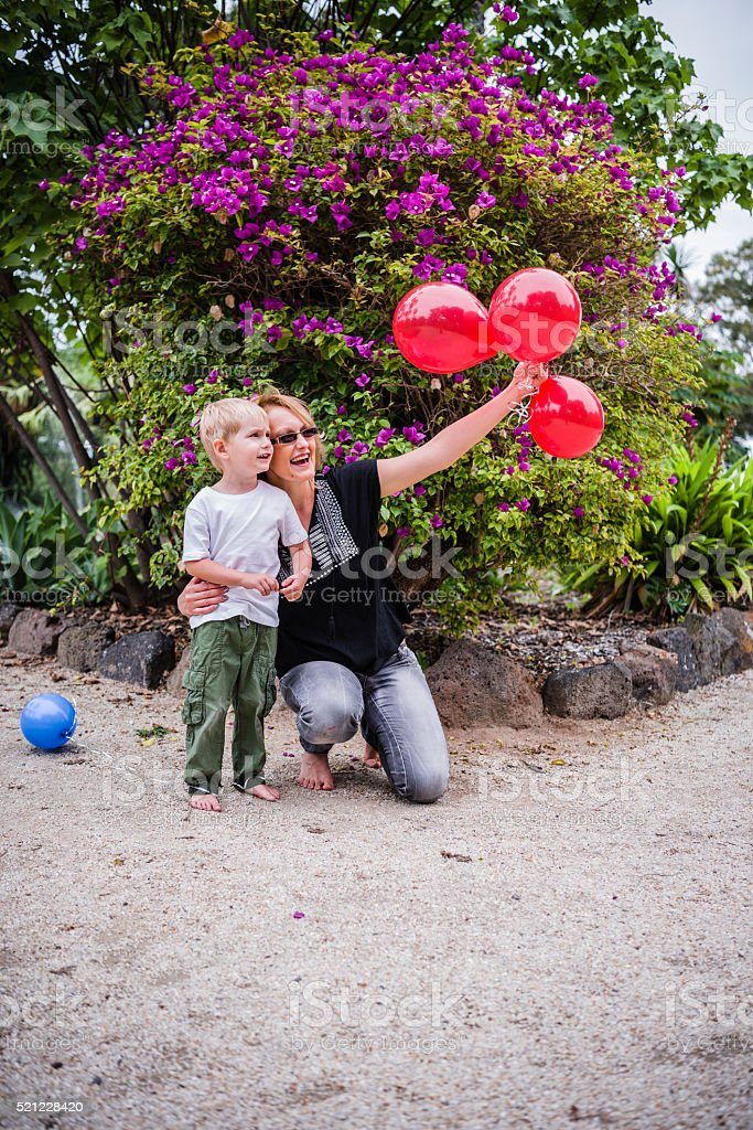 very happy family with balloons stock photo