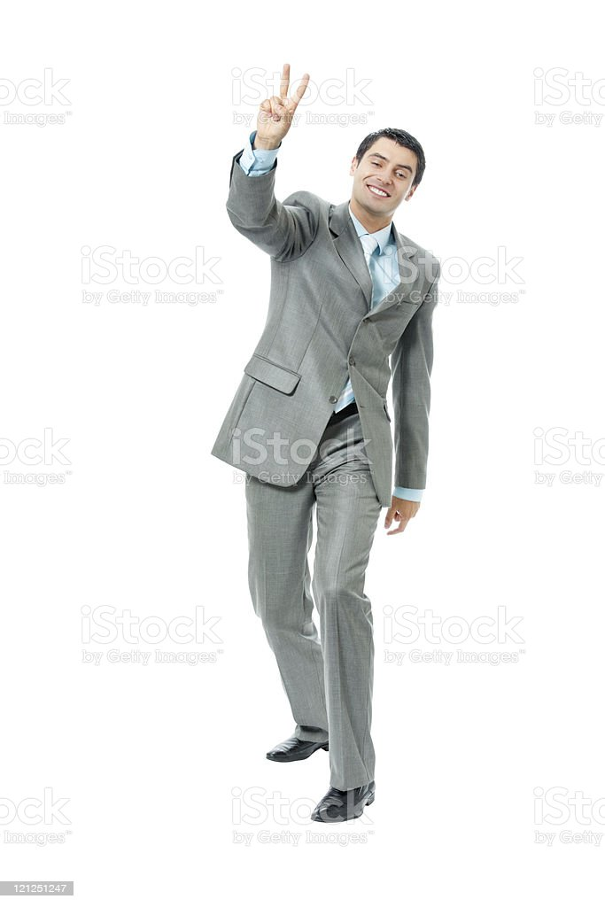 Very happy successful gesturing businessman, isolated stock photo