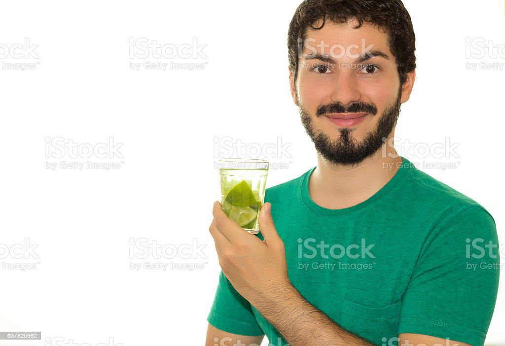 Very happy, this young man is drinking caipirinha. stock photo