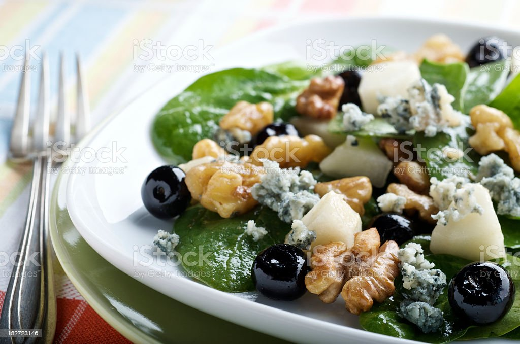 A very healthy spinach salad on a plate stock photo
