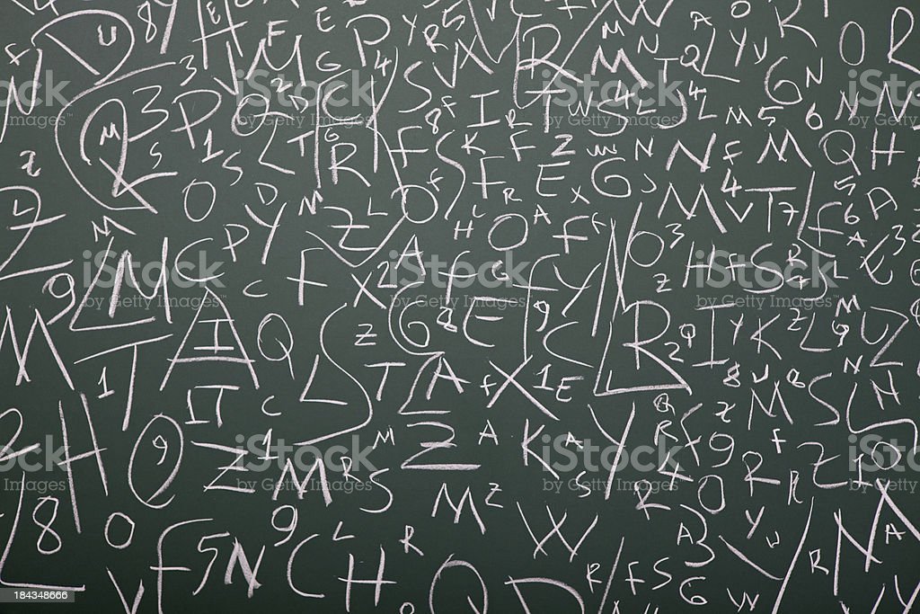Very Large Amount Of Letter Written On Blackboard With Chalk royalty-free stock photo