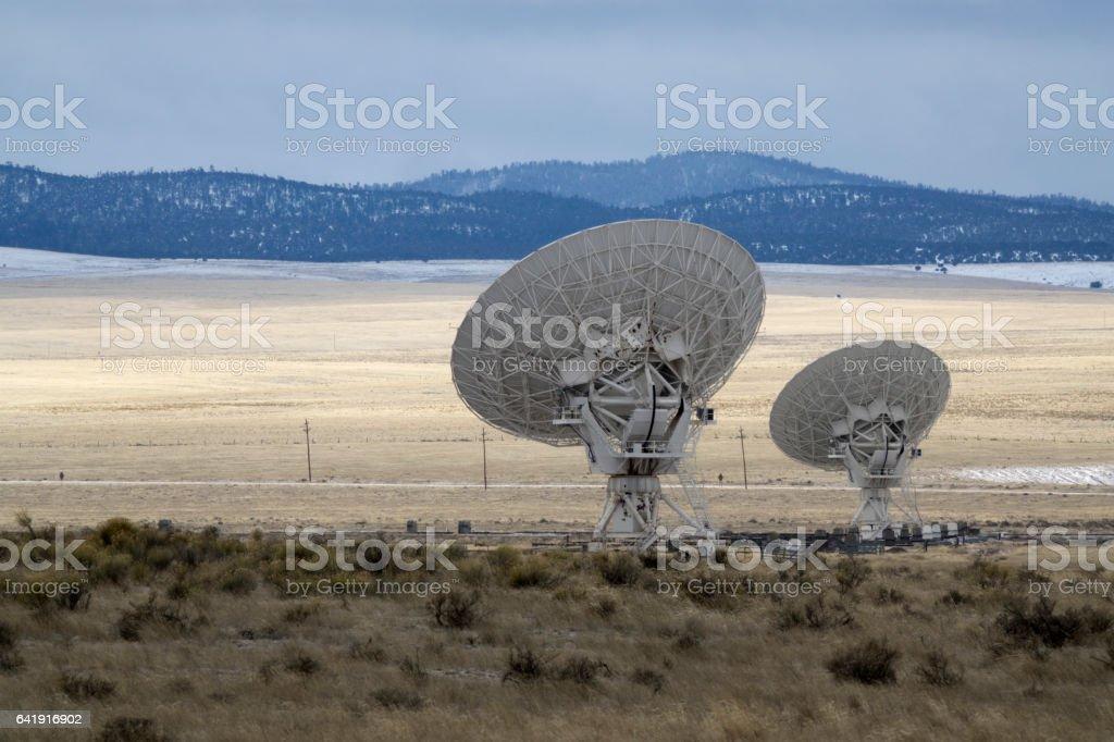 Very Large Array dish radio antenna snowy mountains New Mexico stock photo