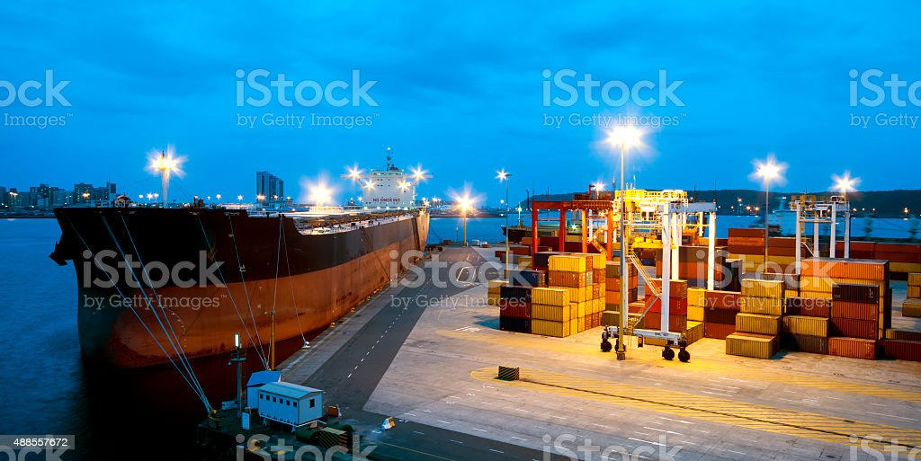 very large ship in the port during cargo operation stock photo