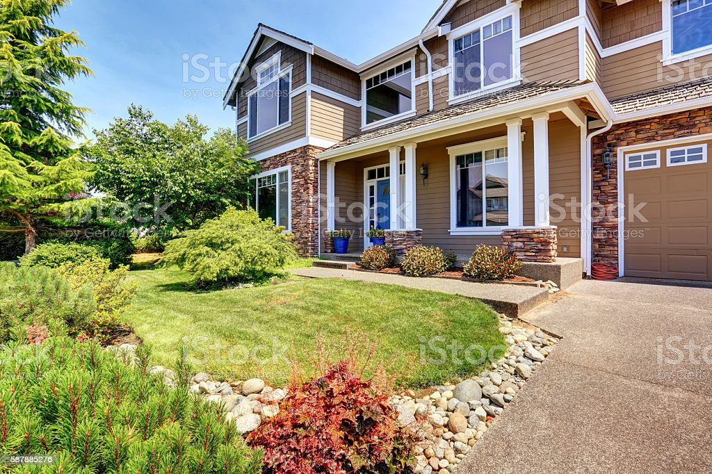 Very neat American house with gorgeous outdoor landscape. stock photo