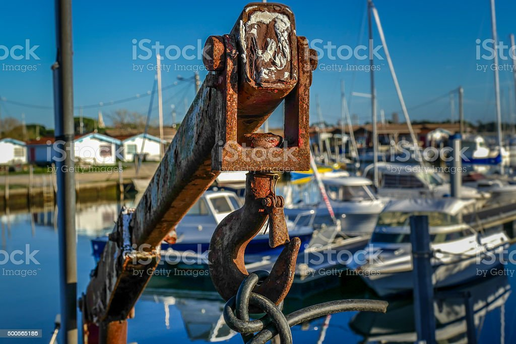 Very old and rusty outboard motor hoist winch stock photo