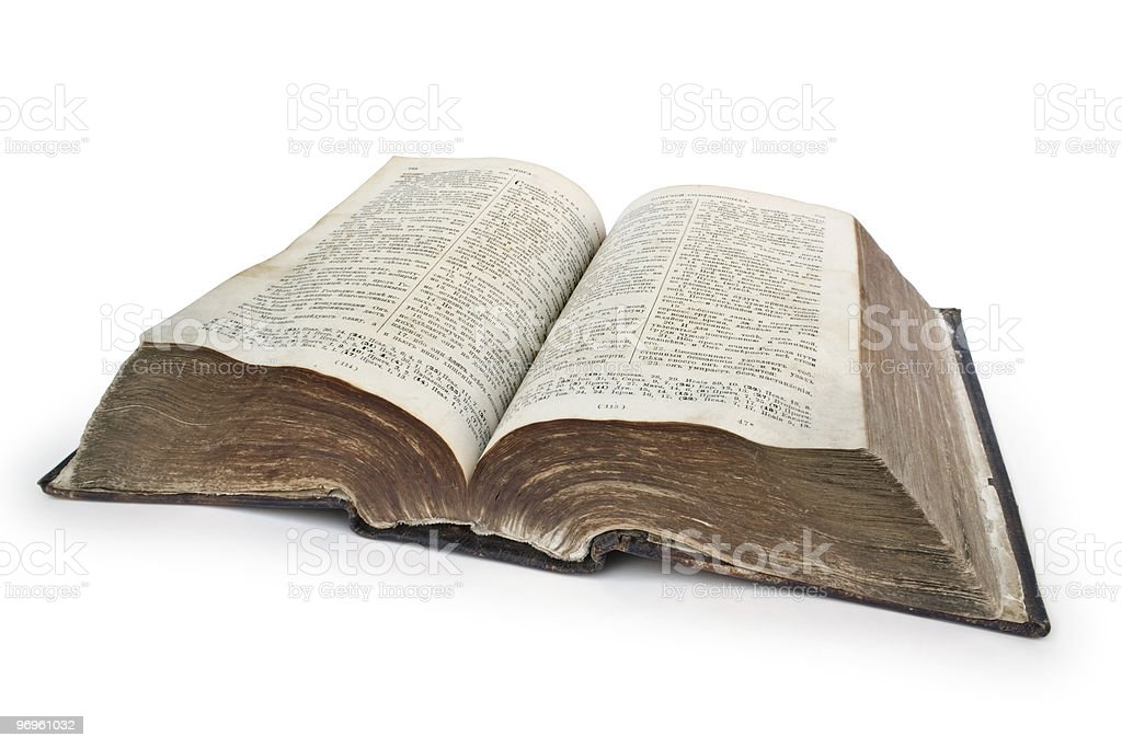 Very old Bible with wrinkled pages stock photo