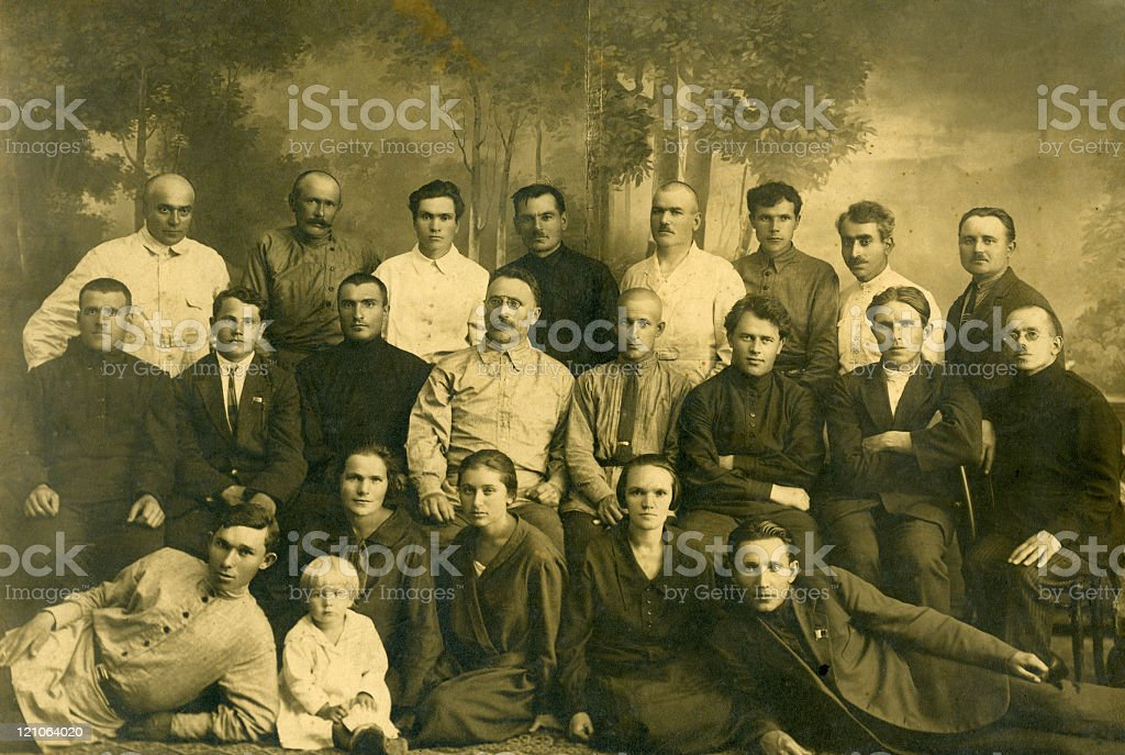 Very old black and white photo of a large family stock photo