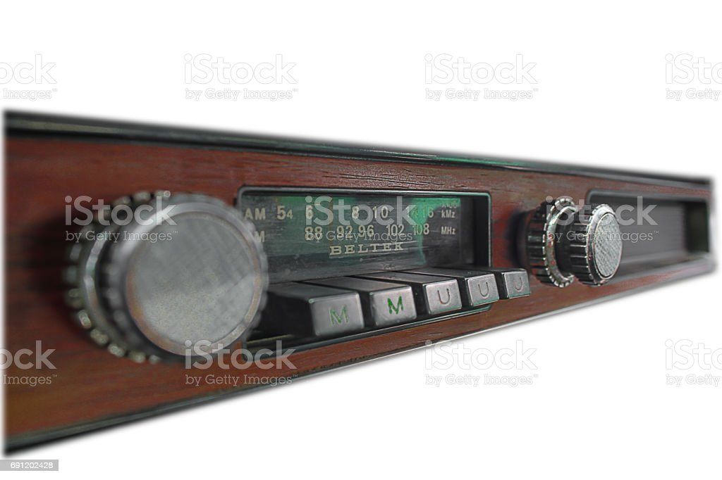 A very old car radio receiver isolated on white background - front panel view. stock photo