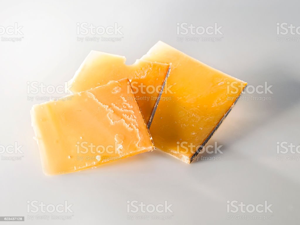 Very old cheese in slices stock photo