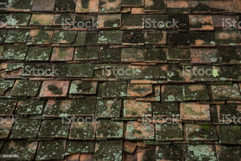 very old dirty roof tile of Thai Asian temple roof style architecture pattern background stock photo