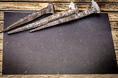 very old large nails on a beautiful wooden background, rusty