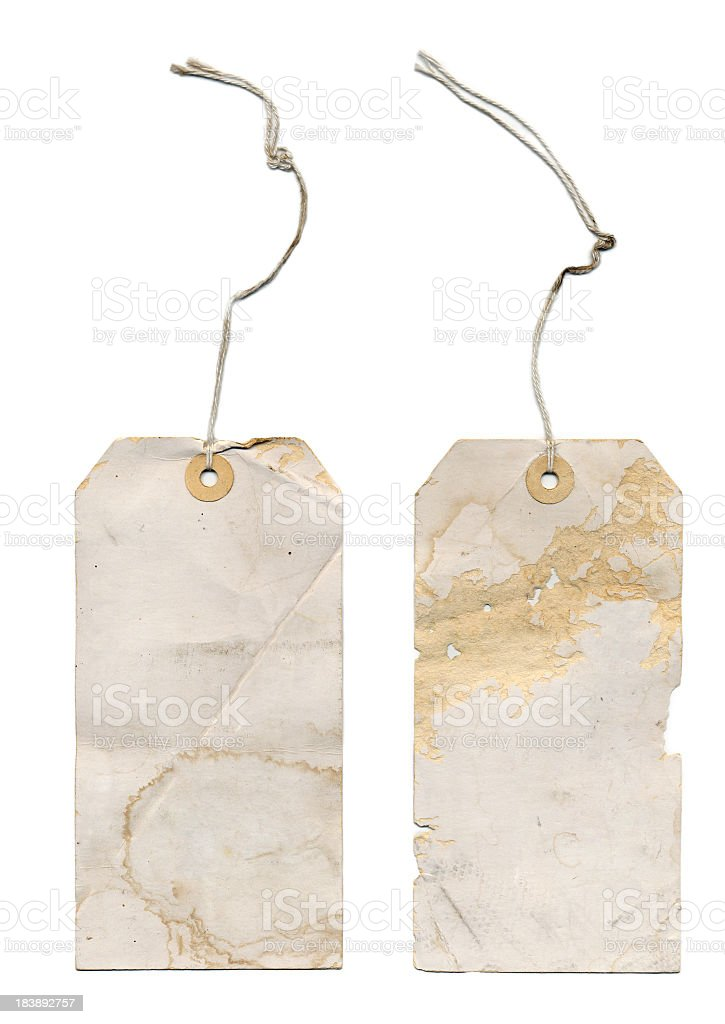 Very Old  Paper Tags with Stings on a White Background stock photo