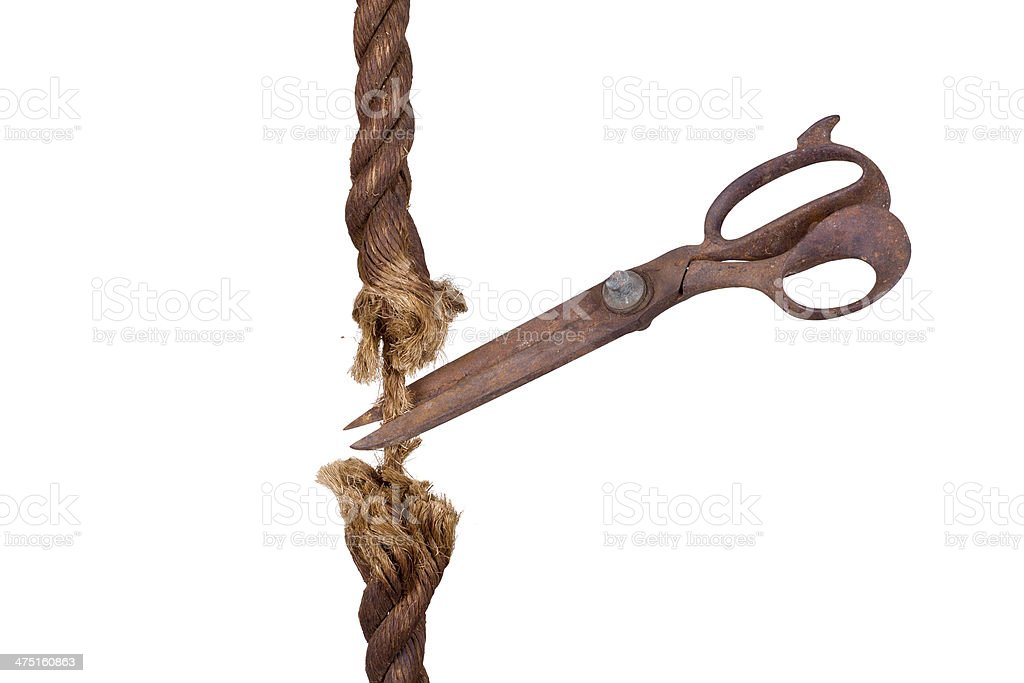 very old robe cutting by aged scissors royalty-free stock photo