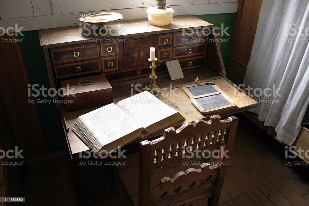 Very old study with desk and open book stock photo