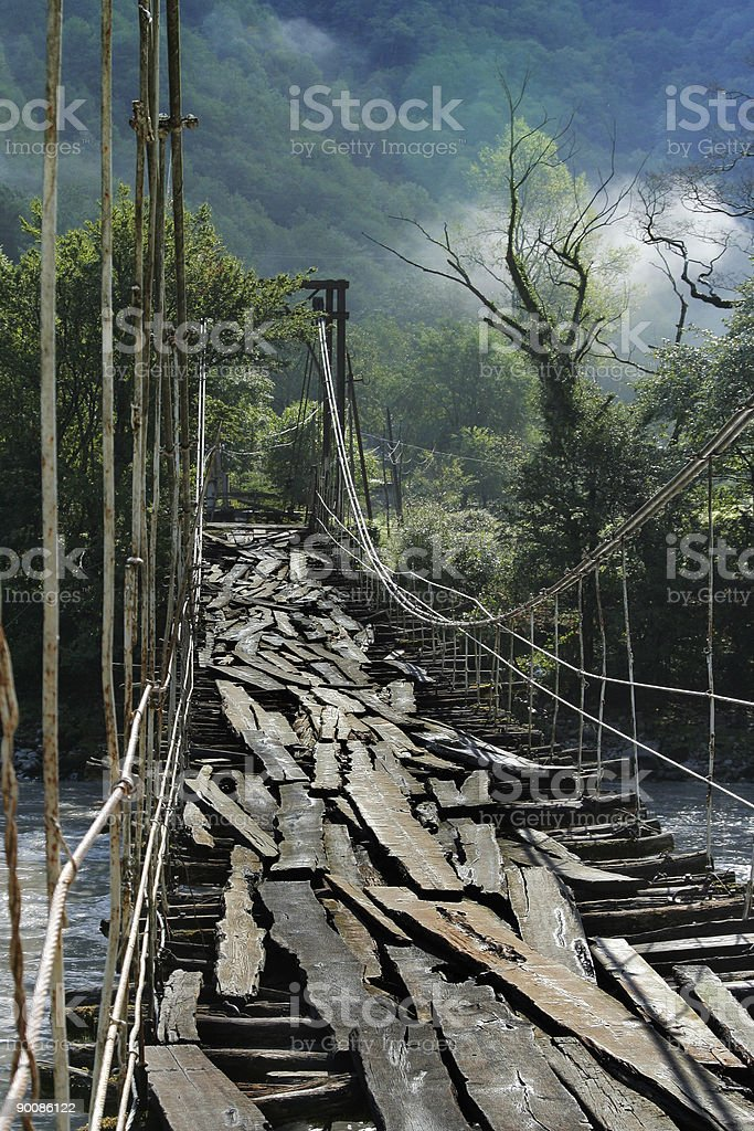 very old suspension bridge royalty-free stock photo