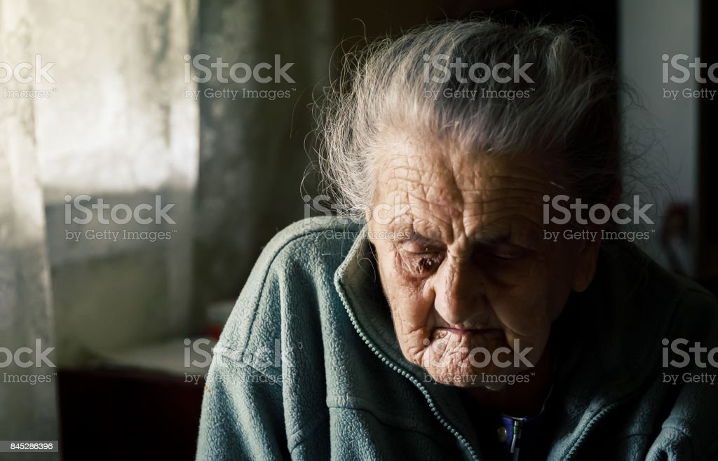 very old tired woman stock photo