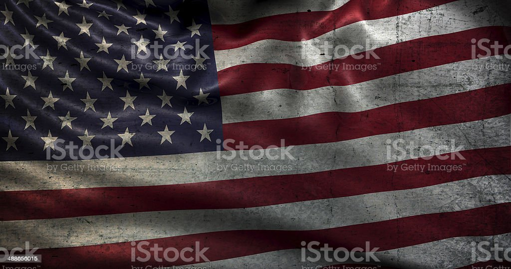 Very old USA flag damaged over time stock photo