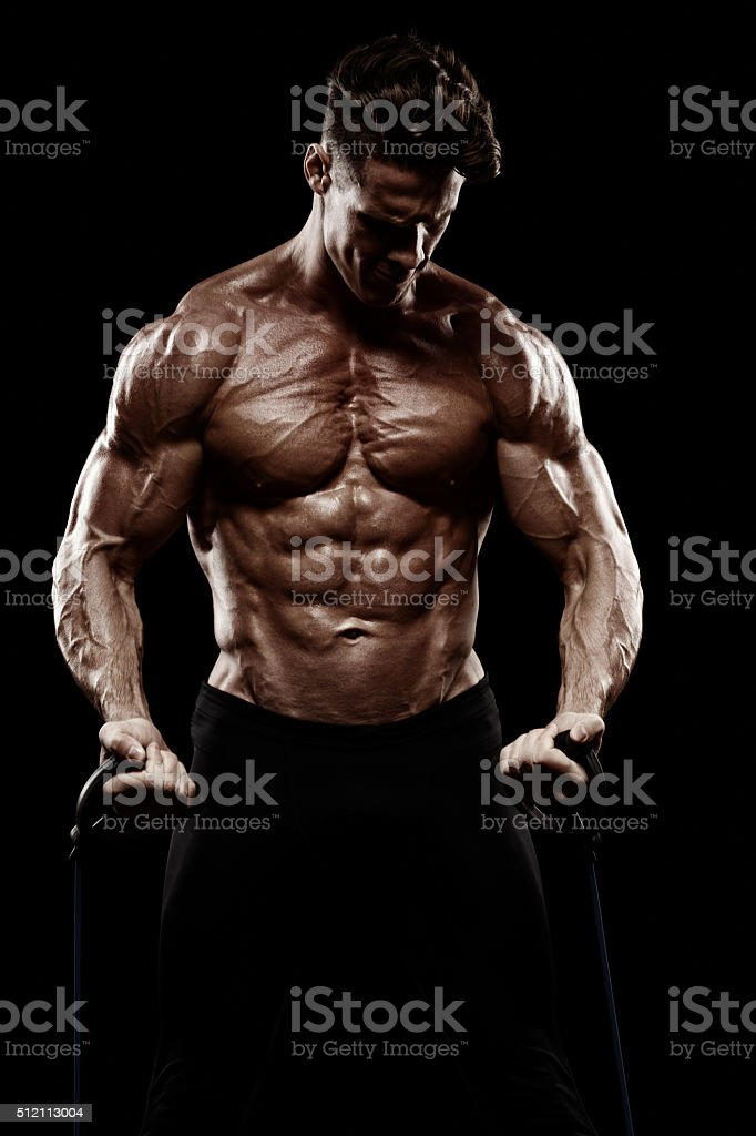 very power athletic guy , execute exercise on on sport-apparatus stock photo