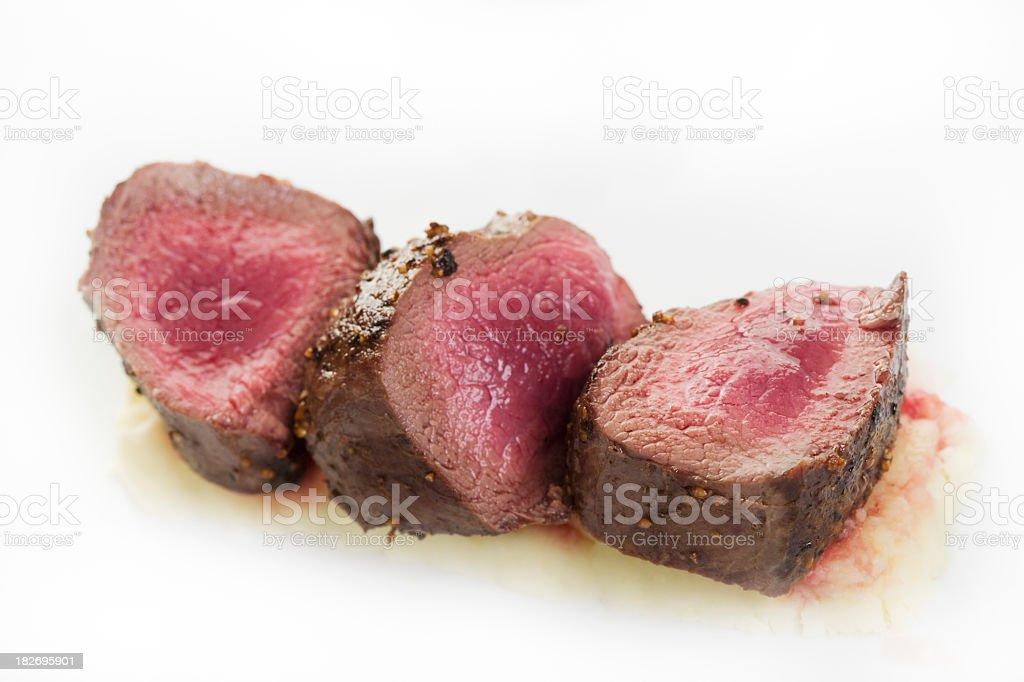 Very raw looking venison steak stock photo