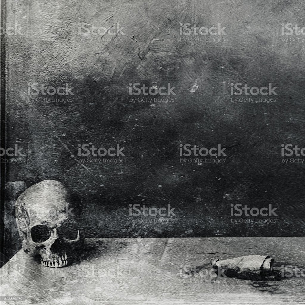 Very scary skull on table. Textured grunge black and white stock photo
