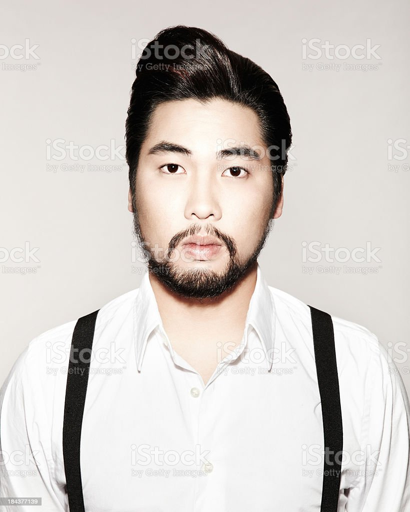 Very serious Asian business man looking at camera royalty-free stock photo