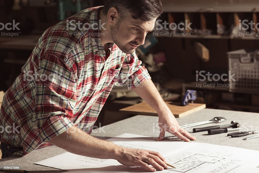 Very skilled young carpenter stock photo