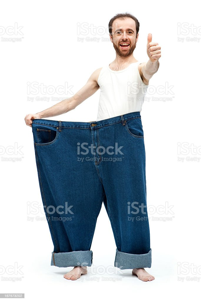 Very slim man and his large pants royalty-free stock photo