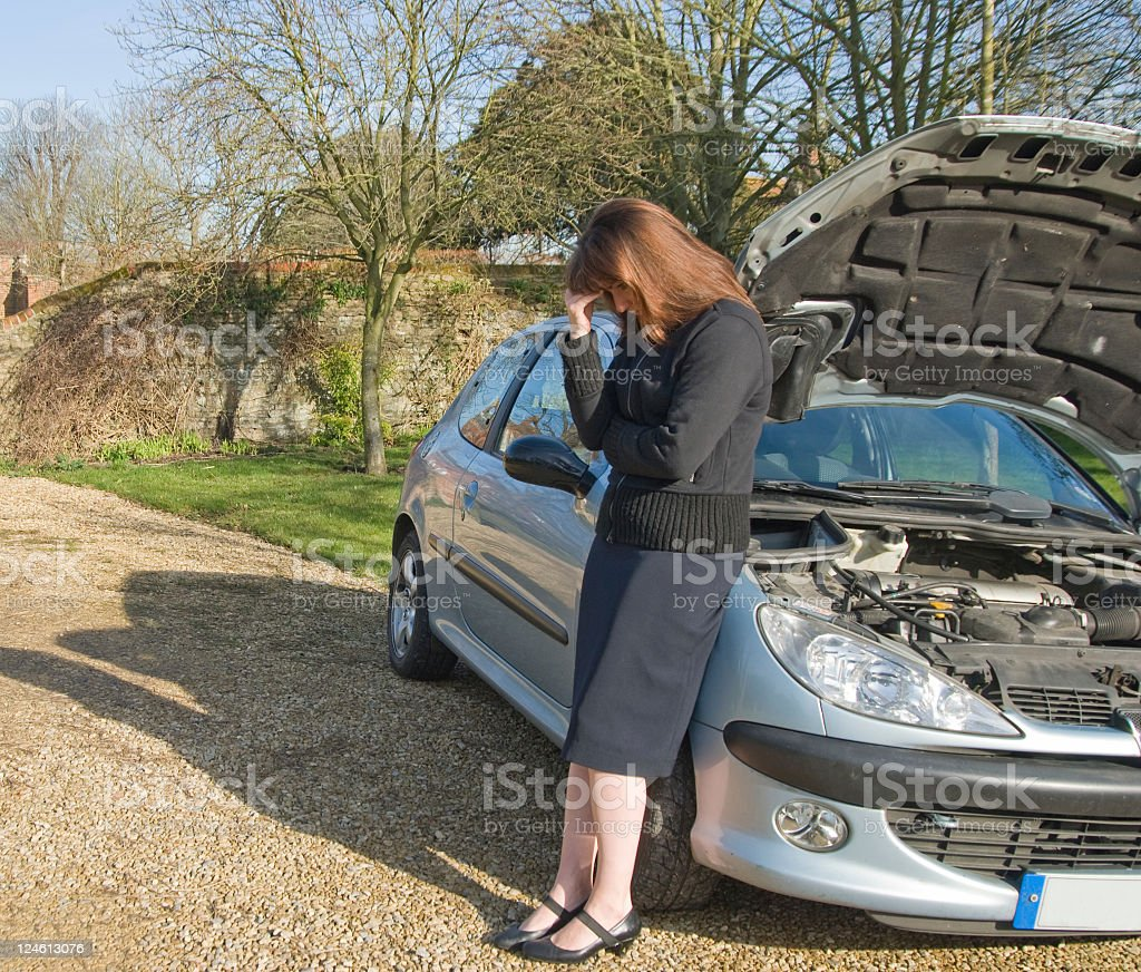 Very stressed Women by car stock photo