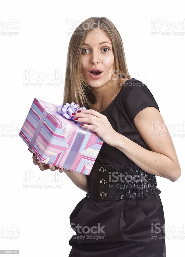 Very surprised girl holding a gift box royalty-free stock photo
