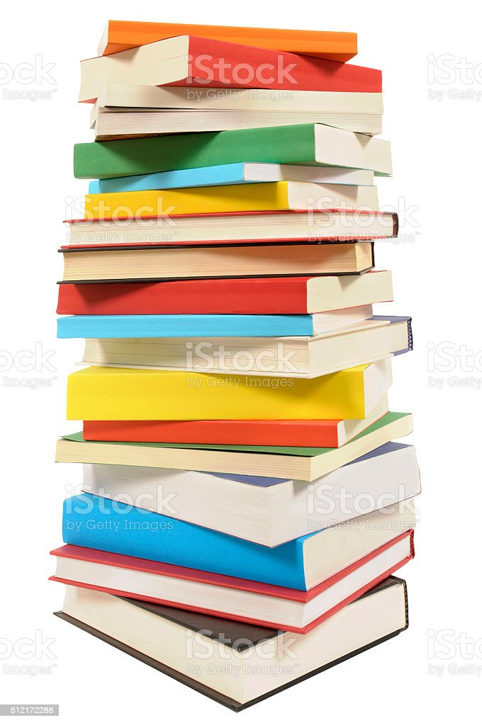 Very tall pile of books isolated on white background stock photo