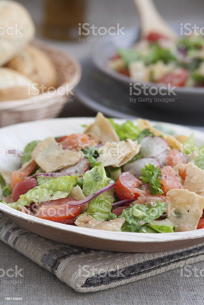 Very tasty Arabic salad (Fattoush) served in bamboo leaf plate stock photo