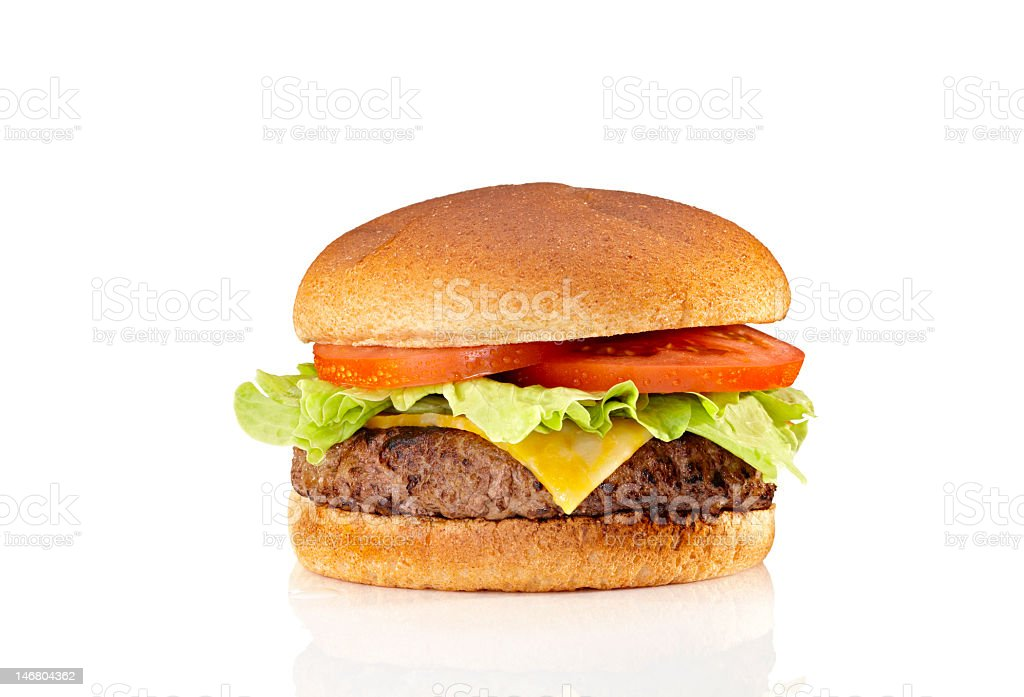 A very tasty cheeseburger with tomatoes and lettuce  stock photo