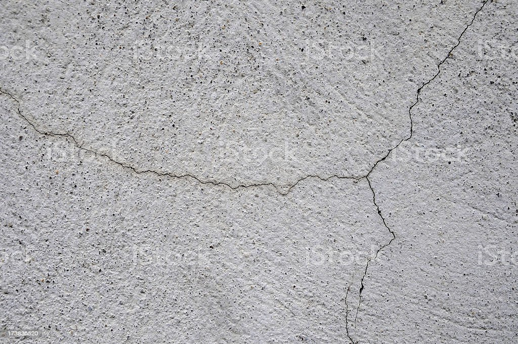 very thin crack in wall stock photo