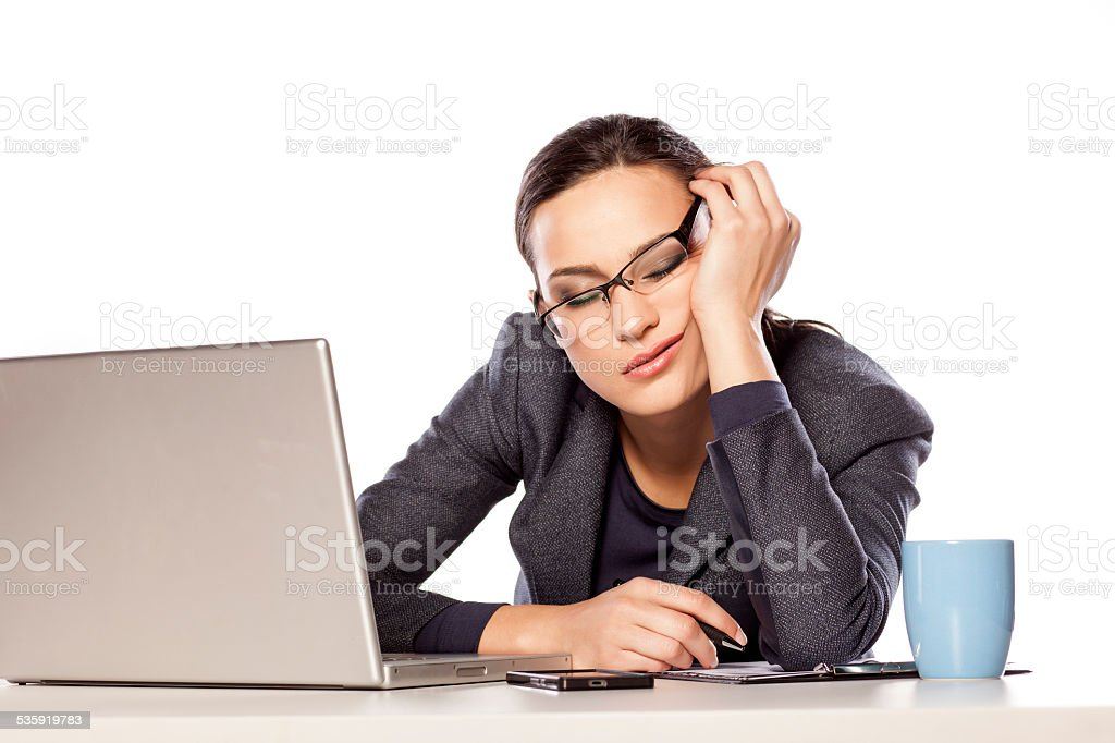 Very tired business woman fell asleep leaning on her hand stock photo