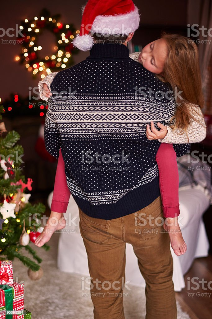 Very tired girl carried by her father stock photo