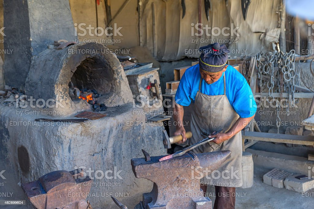 Very traditional way to make Kitchen Knife in rural China stock photo