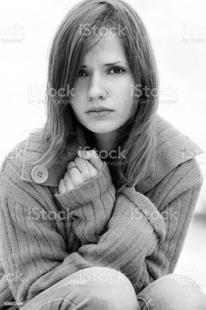 Very upset, sad and depressed, but attractive, nice fashionable girl stock photo