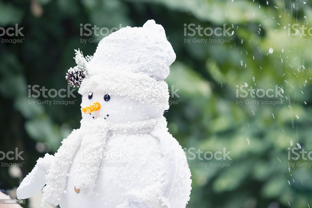 Very warm snowman stock photo