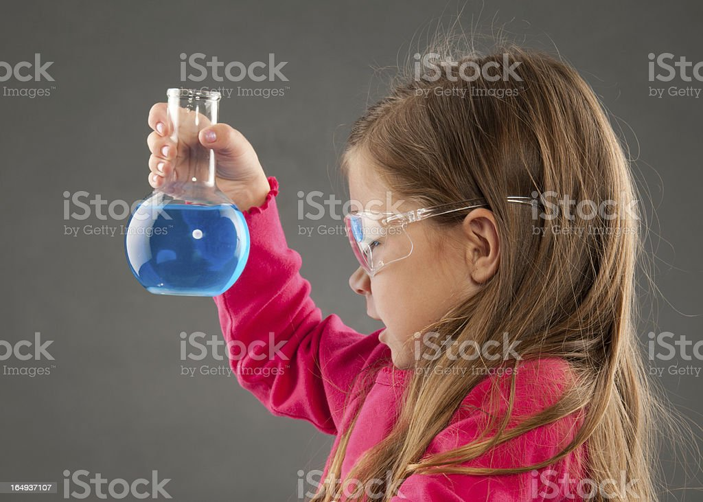 Very Young Scientist Conducting Experiment stock photo