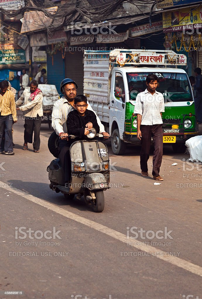 Vespa rider with child on early morning stock photo