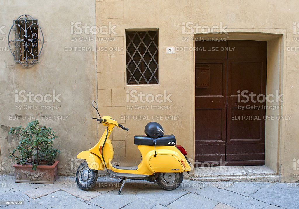 Vespa scooter in an ancient Tuscan village royalty-free stock photo
