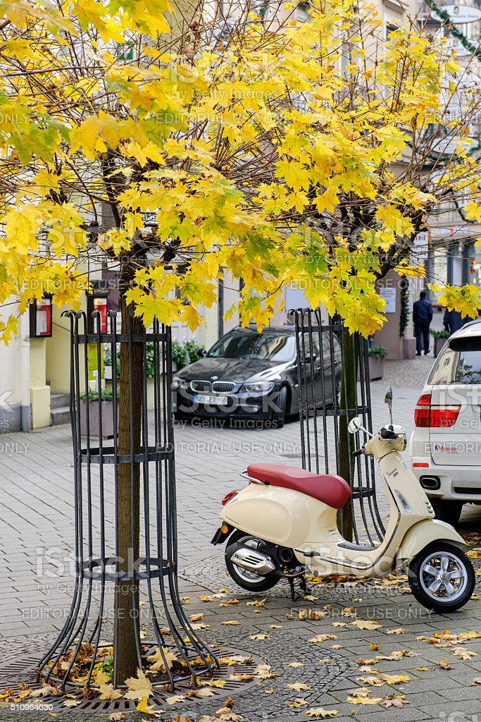 Vespa scooter parked in beautiful city stock photo