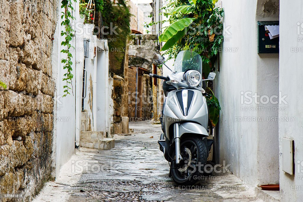 Vespa scooter standing in a street, Rhodes, Greece stock photo