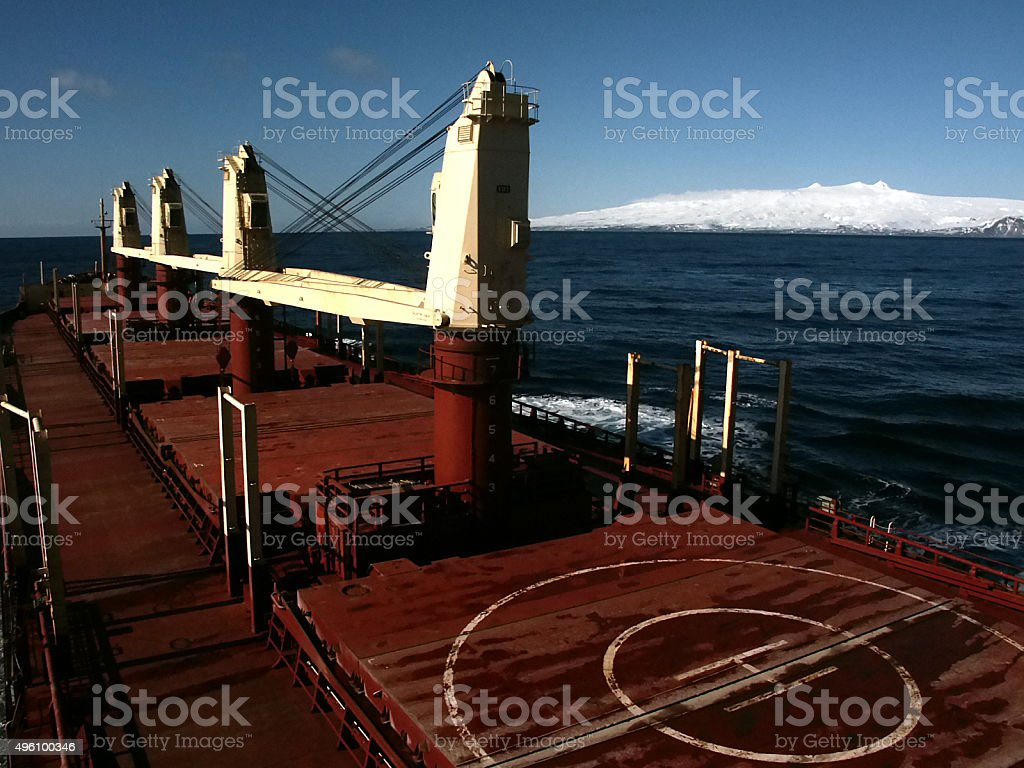 Vessel & Aleutian Islands and Snow Covered Mountains stock photo