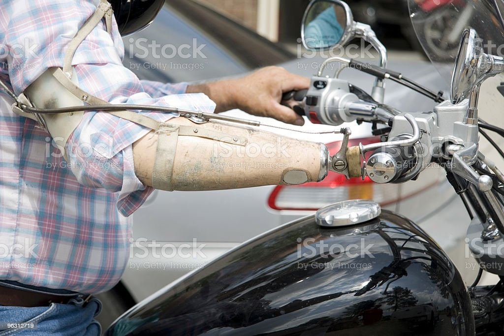 Vet with Prosthesis Riding a Motorcycle stock photo