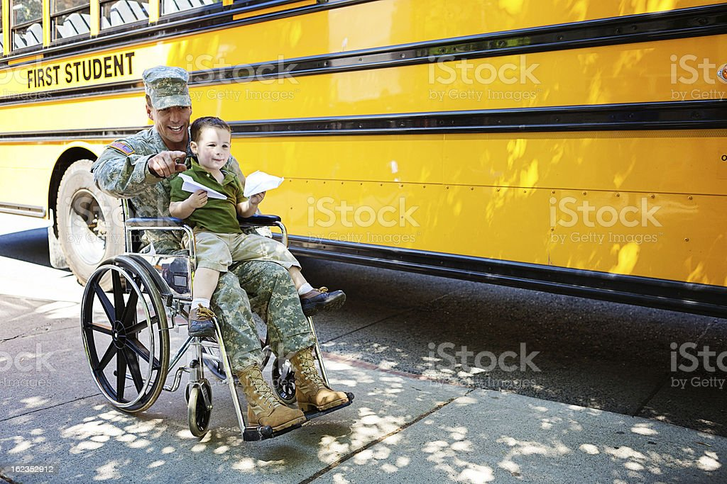 Veteran and boy in wheelchair stock photo
