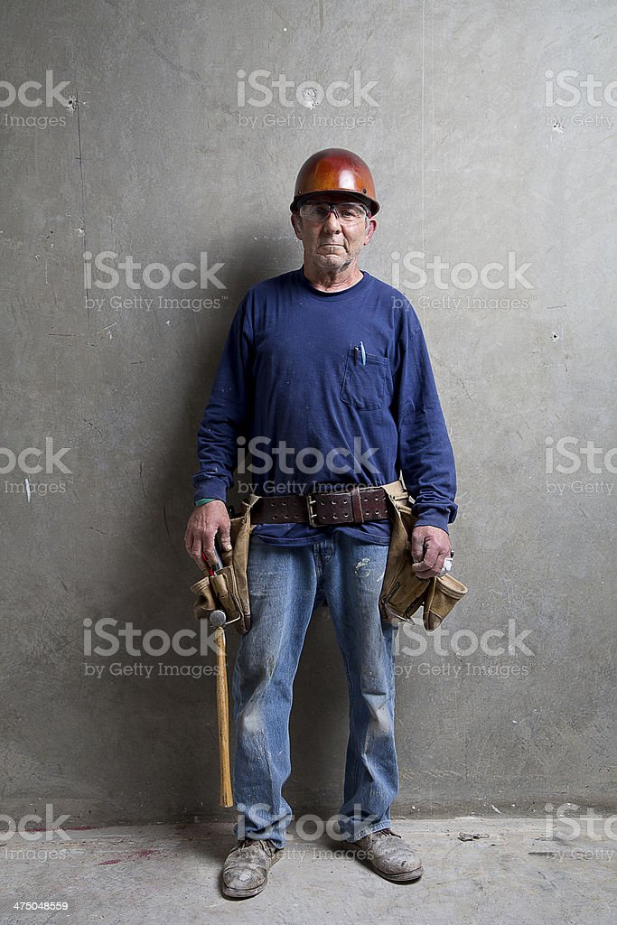 Veteran construction worker with his tools royalty-free stock photo