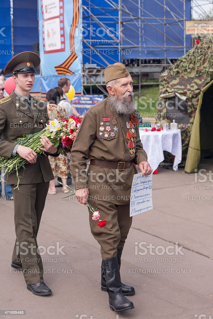 Veteran of war in WWII uniform look for brother-soldiers royalty-free stock photo